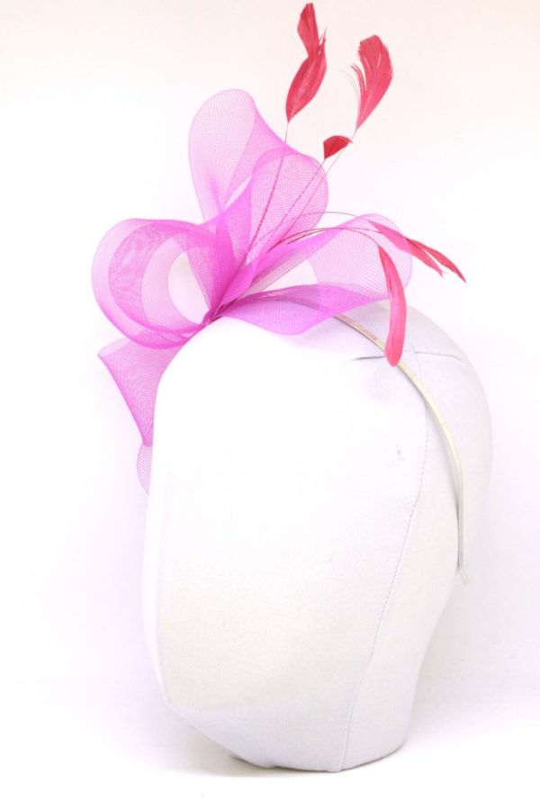 bow with feathers on a hairpin