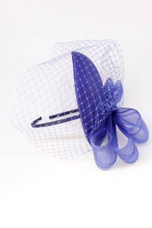 a royal blue toque with veiling and a bow
