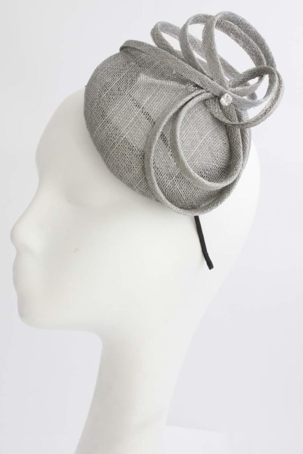 silver toque with twists and a crystal