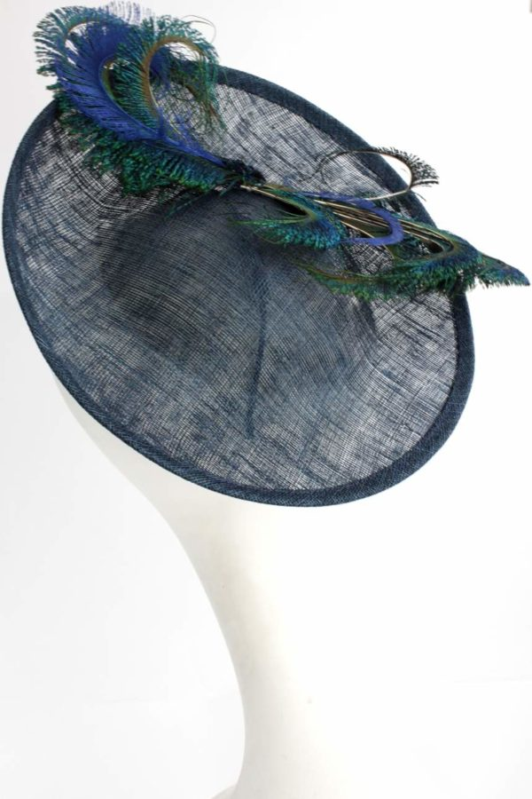elegant toque with peacock feathers