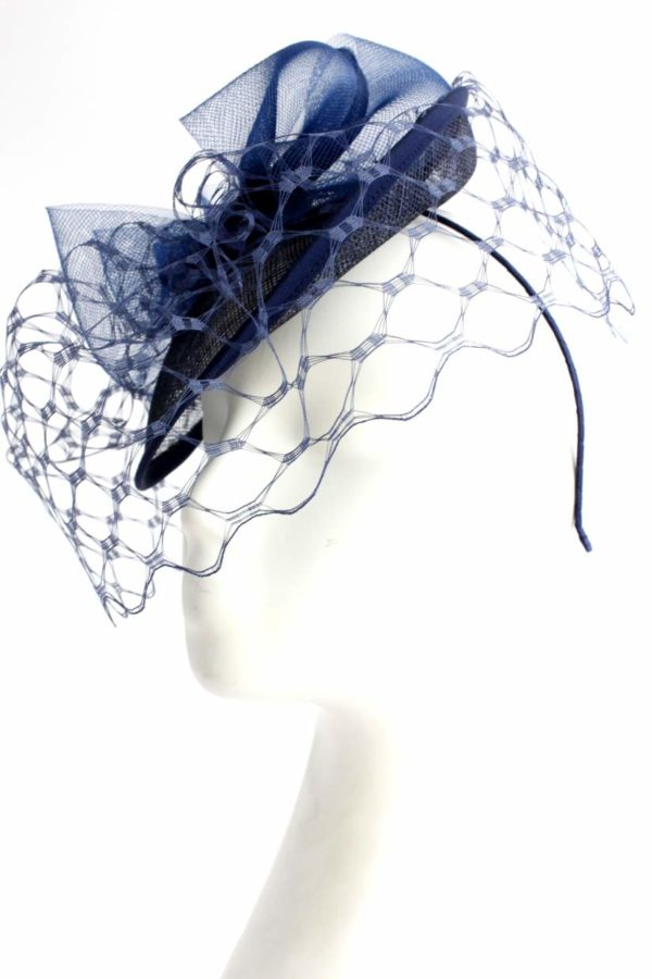 navy blue toque with a veiling and a bow