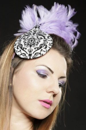 black and white toque with violet feathers