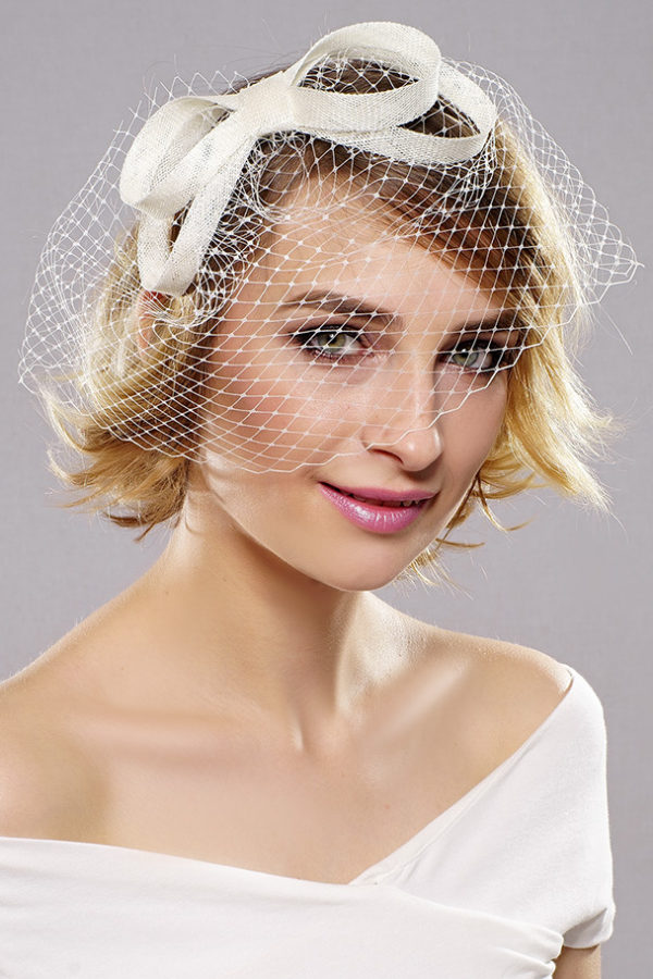 fascinator with veilin and a bow