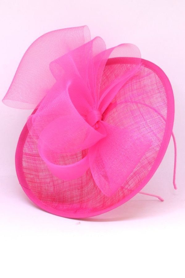 elegant pink toque with a delicate bow