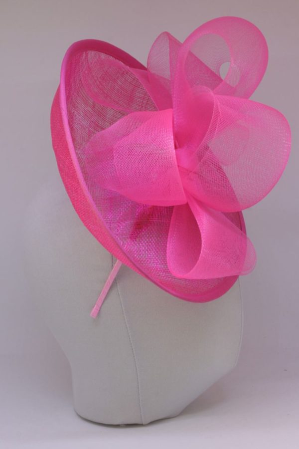 elegant pink toque with a bow